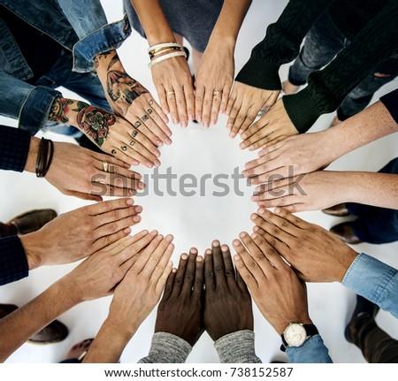 Diverse People Hands Together Partnership #738152587