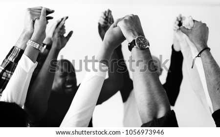 Diverse people joining hands together teamwork and winning concept