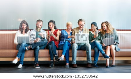 Diverse people using digital devices #1352750642