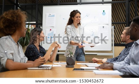 Diverse staff and business trainer starting seminar lecturer giving learning material for workshop, corporate clients or investors receiving statistical financial data before negotiating and analysing
