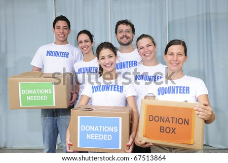 diverse volunteer group with food donation boxes
