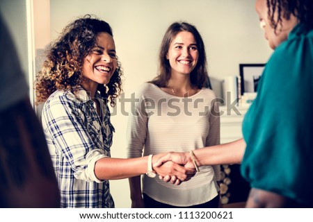 Diverse woman shaking hands Stock photo ©