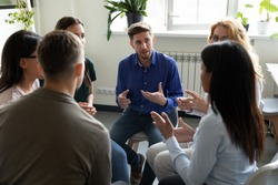 Diverse workgroup solve current issues, discuss common project, taking part in team building talk. Psychologist counselor therapist speak at group therapy session, psychotherapy meeting rehab concept