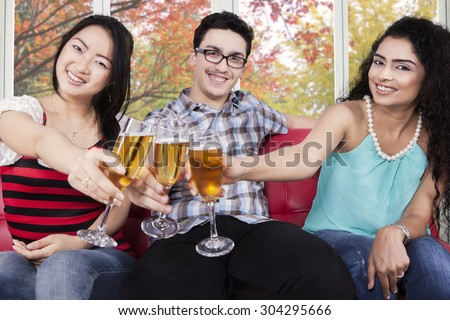 Diversit: people drinking and toasting champagne with autumn background Foto d'archivio ©