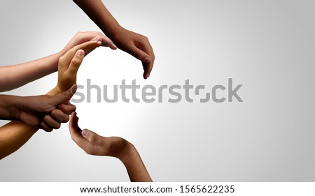 Diversity and unity partnership as a business startup and teamwork or togetherness concept with hands joined together in a group of diverse connected people.