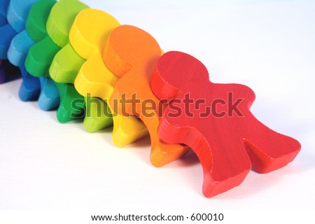 Diversity - colorful, wooden domino people falling down.