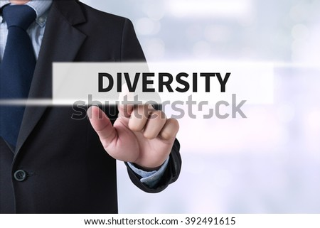 DIVERSITY CONCEPT on the tablet pc screen held by businessman hands - online, top view #392491615