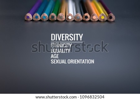 Diversity concept. row of mix color pencil on black background with text Diversity, Ethnicity, Equality, Age, Sexual Orientation #1096832504