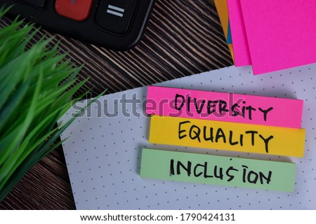 Diversity Equality Inclusion write on a sticky note isolated on Office Desk.