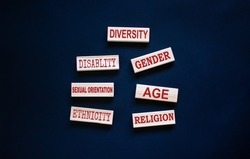 Diversity ethnicity gender age sexual orientation religion disability words written on wooden block. Beautiful black background. Equality and diversity concept.