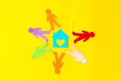 Diversity, inclusion, adoption concept. Colorful paper cut figure yellow background