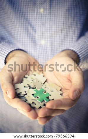 diversity of puzzle piece on handful