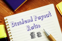 Dividend Payout Ratio phrase on the piece of paper.