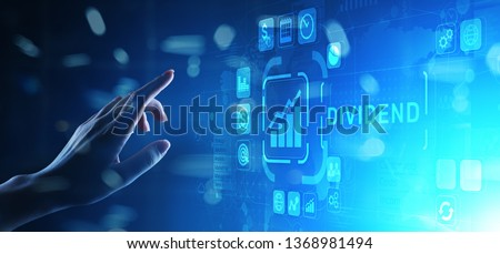 Dividends button on virtual screen. Return on Investment ROI financial business wealth concept on virtual screen. Photo stock ©
