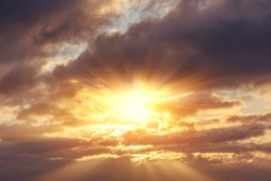 Divine glow through the clouds of the evening warm sun. Concept of peace and happiness.