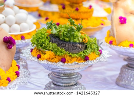 Divine offerings in Hinduism include flowers, incense, candles, food and fruits.