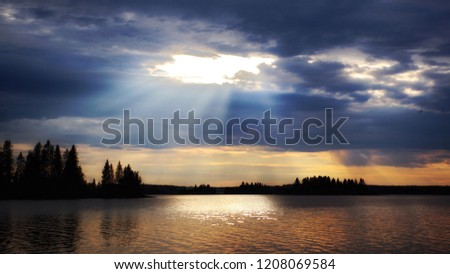 Divine sky over calm sea and landscape with heavenly light pours down.