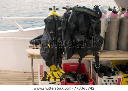 diving equipments. balloons, aqualungs, fins, flippers on a yacht, boat. Scuba diving. divers. sport and hobby #778063942
