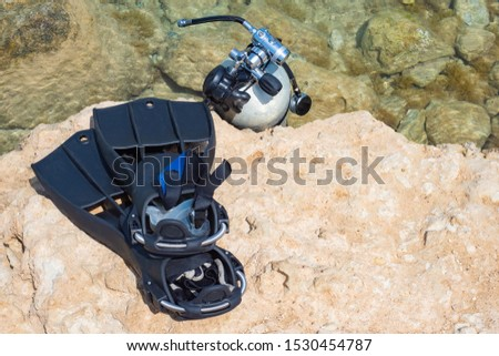 Diving. Fins and mask for diving lie on the beach. Underwater swimming. Dive under the water. Diving with a mask. Sport. Hobby. Leisure. Tourism. #1530454787