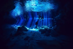 diving in the cenotes, mexico, dangerous caves diving on the yucatan, dark cavern landscape underwater