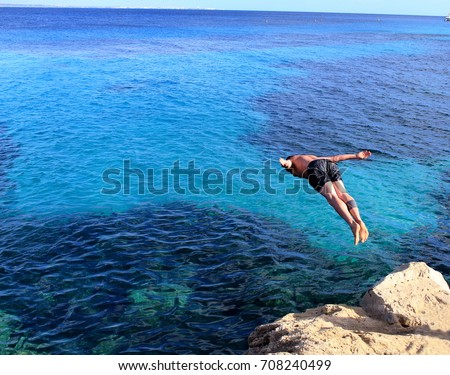 Diving into the sea. Summer holidays #708240499