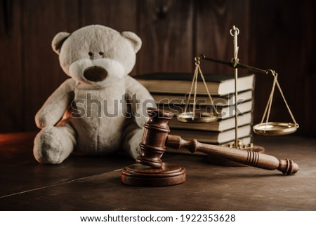 Divorce and alimony concept. Wooden gavel and teddy bear in notary public office