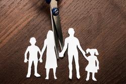Divorce and child custody scissors cutting family apart.