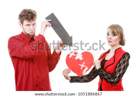 Divorce and separation concept. Couple have serious crisis in relationship. Husband and wife leave each other after argument. People with broken plaster heart. #1051886867