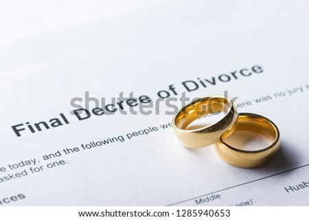 Divorce decree form with marriage ring and pen #1285940653
