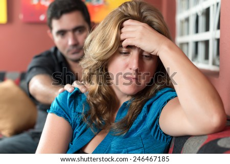 Divorce, marital problems - Sad wife with her husband in the background