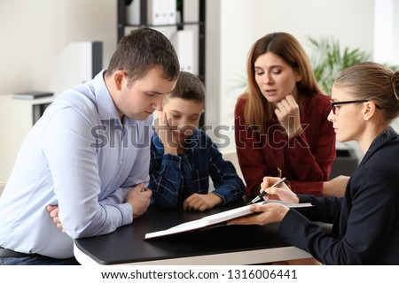 Divorced parents with their son visiting lawyer. Concept of child support #1316006441