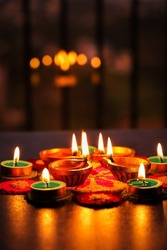 Diwali celebration Indian festival of lights Diya oil lamp and colors Rangoli decoration bright colorful flowers flowerbed copy space greetings Deepavali Hindu festival North India, Mumbai Delhi India