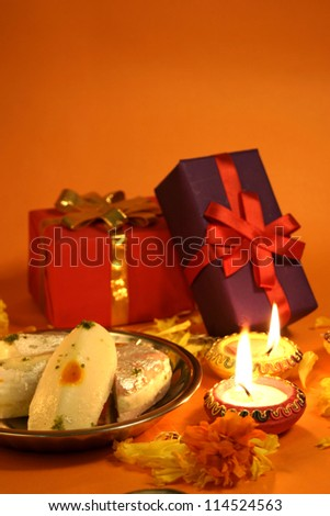 Diwali festival celebration with gifts sweets and lamps