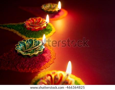 Diwali oil lamp - Colorful clay diya lamps lit during diwali celebration
