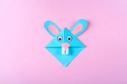 DIY and kid's creativity, origami. Step by step instruction: how to make bookmark easter bunny. Step 9 Finished bookmark for book, funny rabbit. Easter craft
