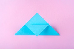 DIY and kid's creativity, origami. Step by step instruction: how to make bookmark easter bunny. Step4  Bend top of triangle to middle of lower side. Easter craft