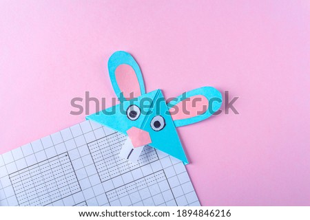 DIY and kid's creativity, origami. Step by step instruction: how to make bookmark easter bunny. Step 9 Finished bookmark for book, funny rabbit. Easter craft Сток-фото ©