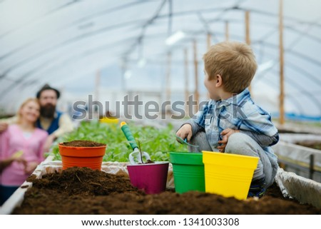 diy garden. home diy garden with child and parents. diy garden hobby. diy garden with happy family. nature needs your care #1341003308