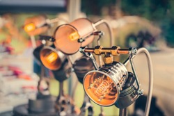 DIY lamps made utilizing old car parts and edison bulbs