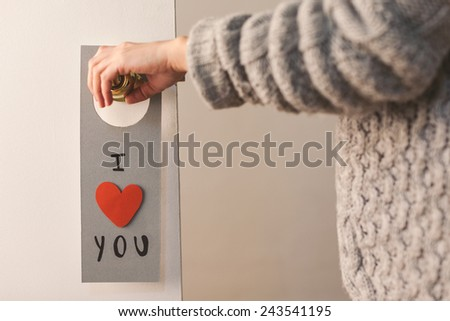 Diy note from Valentine\'s day./ Valentine\'s day lovely message hanging on a door.