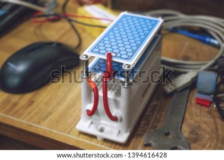 DIY Ozone Generator, ozonizer. Heavy Duty Ozone Generator DIY with Blue Plates Treatment. Selective focus #1394616428