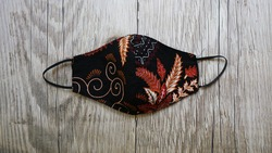 DIY projects handmade crafts batik face masks made out of cotton fabric with red and black color, batik motif