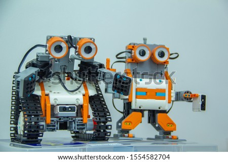 DIY Robots,Artificial robots on a white background,Hand made robot working on taplet computer,
