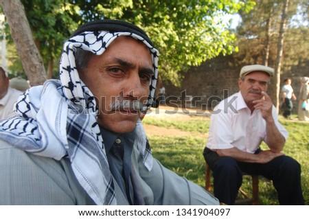 Diyarbakir/Turkey, March 2019: Kurdish men sitting in the old city of the mainly-Kurdish city of Diyarbakir  #1341904097
