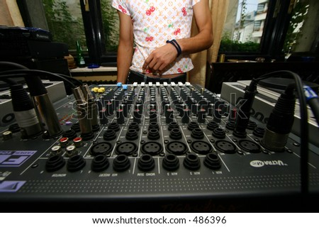 DJ and his desk - stock photo