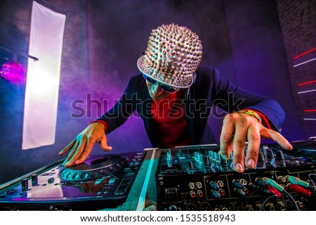 Dj and turntable in the night club