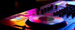 DJ controller close up view in live performance night club dance music