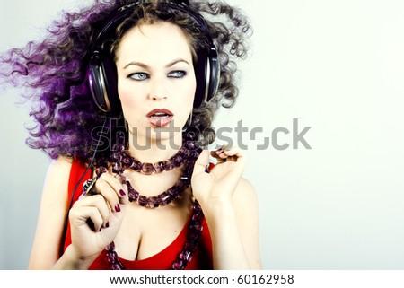 DJ girl listening music in headphones