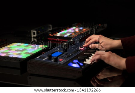 Dj hand remixing music on midi controller #1341192266