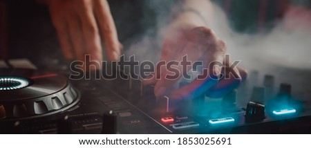 DJ Hands creating and regulating music on dj console mixer in concert nightclub stage Сток-фото ©